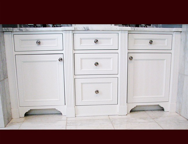 White Lacquer Maple Bathroom Vanity. Double sink and drawer cabinets. Fluted columns. Decorative kick.