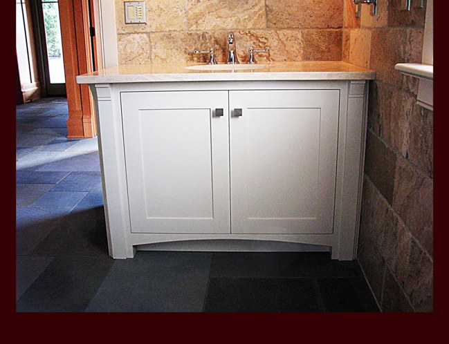 Painted Bath Vanity. Decorative flat column with corbel. Decorative arch kick.