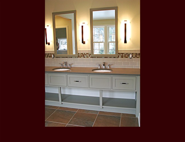 Open Vanity with double sink and stationary lower shelving.