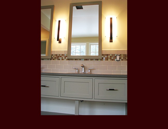 Bathroom vanity with framed mirrors to match.