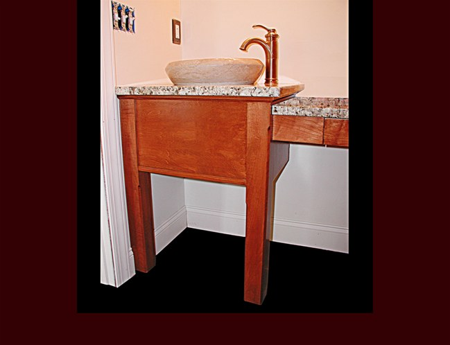 Stained maple vanity with flat skirting and posts.