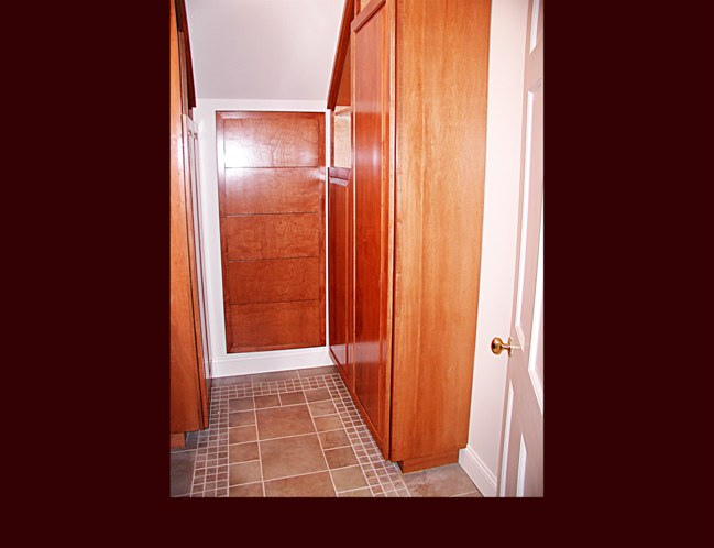 Bathroom cabinetry. Raised Panel Wardrobe built-ins with shelves. Drawer built-in under staircase.