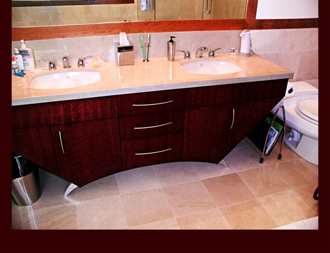 Bird's Eye Maple Master Bath Vanity. Contemporary slab fronts. Mahogany dyed finish. Stainless steel legs.