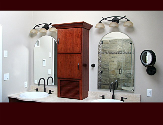 Cherry Bath Cabinet over vanity. Slab door style with tambour storage. Cove crown moulding.