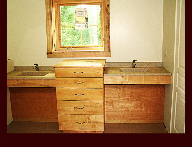 Hickory Master Bath Double Sink cabinetry with center drawer base. ADA Handicap Accessible sinks. Modern slab design.