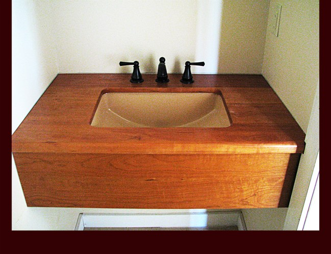 Cherry Skirt and Wooden Top Bath Sink cabinet. Marine Spar Varnish Finish.