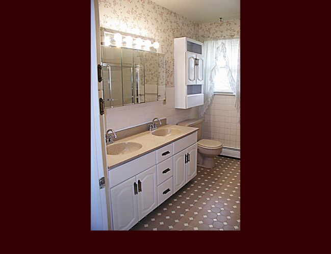 Refinished Double Sink Vanity Cabinet and Storage Cabinet over toilet.