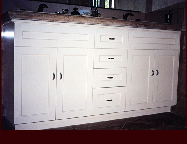 White Painted Double Sink Vanity Cabinet. Flat Panel Full Overlay door style.