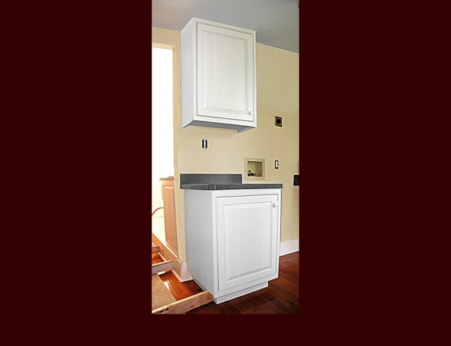 Laundry Room Utility Cabinet. White Painted Raised Panel Overlay door style.