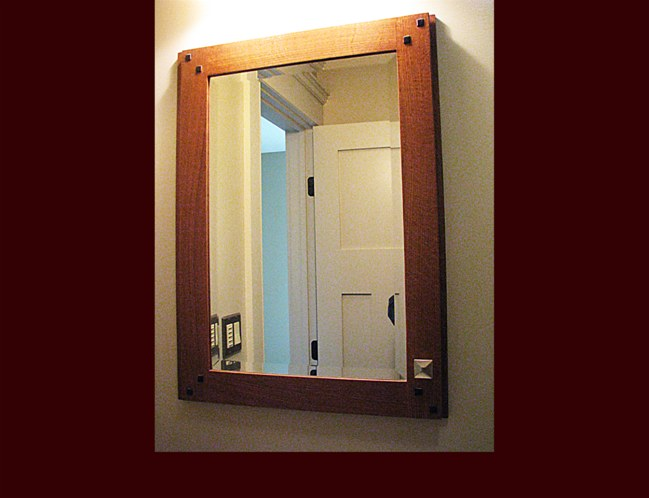 White Oak Stained Medicine Cabinet. Beveled Mirror Glass. Ebony inlays in frame.