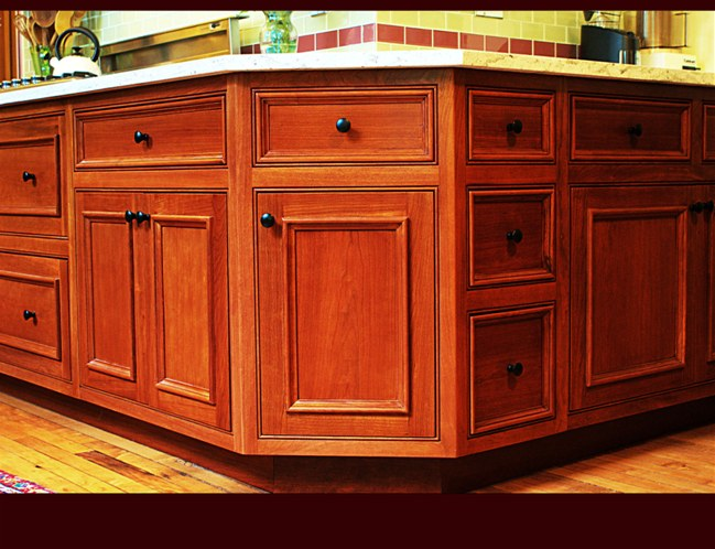 Cherry Kitchen Cabinetry. Flat Panel doors/drawers with applied molding. Inset doors with beaded face frame. Full extension, soft-close drawer guides.