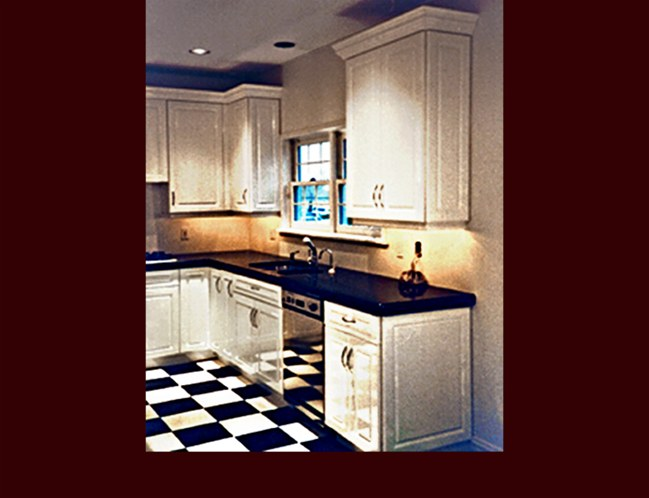 White Lacquer Maple Kitchen Cabinets. Raised Panel door style. Decorative end panels. Crown Moulding. 9' ceiling height.
