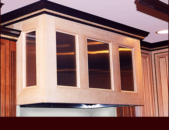 Custom Maple Hood with Stainless Steel Panels. Crown Moulding with rope detail.